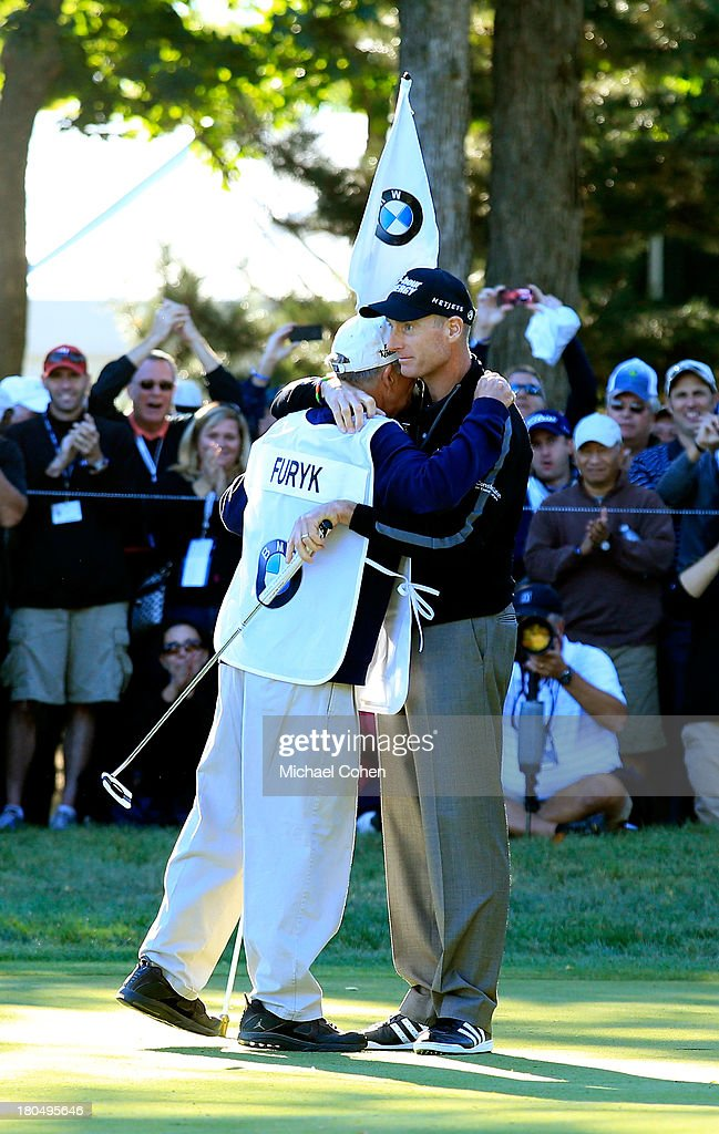 Jim Furyk (R) celebrates with his caddie Mike 'Fluff' Cowan after shooting a 59 during the Second Round of the BMW Championship at Conway Farms Golf Club on September 13, 2013 in Lake Forest, Illinois.