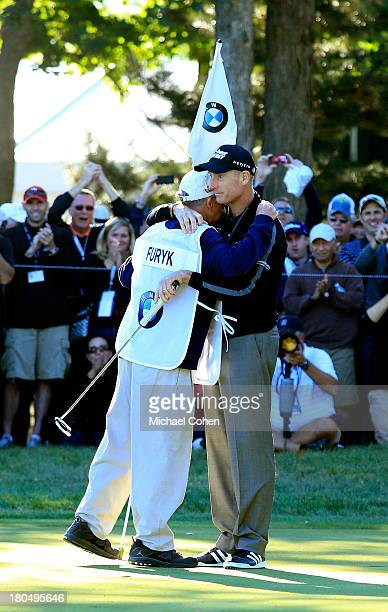 """Jim Furyk celebrates with his caddie Mike """"Fluff"""" Cowan after shooting a 59 during the Second Round of the BMW Championship at Conway Farms Golf Club..."""