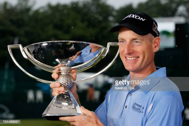 Jim Furyk celebrates with the FedExCup Trophy after winning THE TOUR Championship presented by CocaCola the final event of the PGA TOUR Playoffs for...