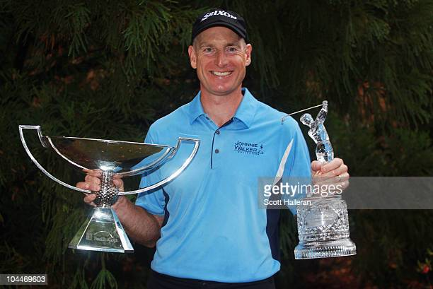 Jim Furyk celebrates with THE TOUR Championship trophy and the FedExCup Trophy after winning THE TOUR Championship presented by CocaCola the final...