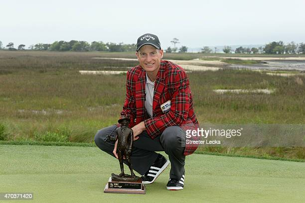 Jim Furyk celebrates with the trophy after winning on the second playoff hole at the RBC Heritage at Harbour Town Golf Links on April 19, 2015 in...