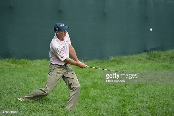 Jim Furyk chips to the 17th green during the final round of the Memorial Tournament presented by Nationwide at Muirfield Village Golf Club on June 7,...