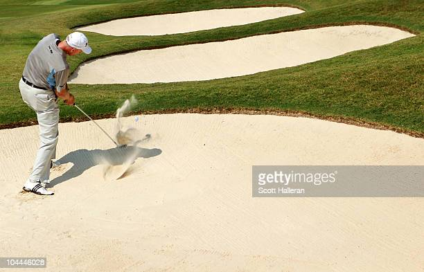 Jim Furyk hits a shot from a bunker on the 17th hole during the third round of THE TOUR Championship presented by CocaCola at East Lake Golf Club on...