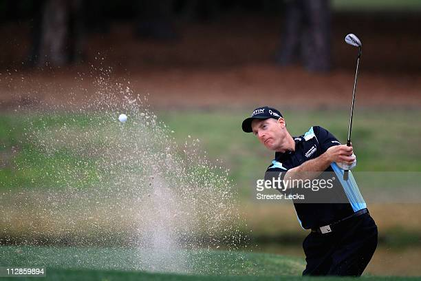 Jim Furyk hits a shot from the sand on the 7th hole during the second round of The Heritage at Harbour Town Golf Links on April 22, 2011 in Hilton...