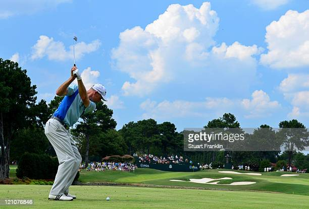 Jim Furyk hits his tee shot on the seventh hole during the third round of the 93rd PGA Championship at the Atlanta Athletic Club on August 13 2011 in...