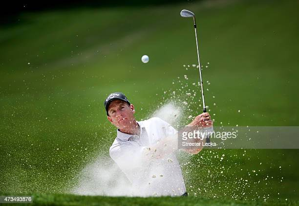 Jim Furyk hits out of the bunker on the fifth hole during round two at the Wells Fargo Championship at Quail Hollow Club on May 15, 2015 in...