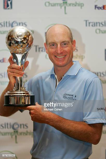 Jim Furyk holds the trophy after winning the Transitions Championship at the Innisbrook Resort and Golf Club held on March 21 2010 in Palm Harbor...