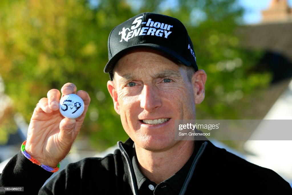 Jim Furyk holds up his ball with a '59' on it after shooting a 59 during the Second Round of the BMW Championship at Conway Farms Golf Club on September 13, 2013 in Lake Forest, Illinois.
