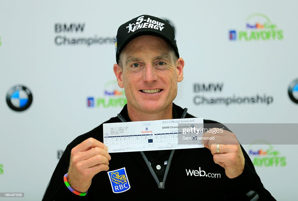 Jim Furyk holds up his scorecard after shooting a 12 under round of 59 during the Second Round of the BMW Championship at Conway Farms Golf Club on September 13, 2013 in Lake Forest, Illinois.
