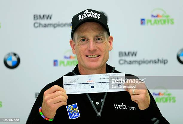 Jim Furyk holds up his scorecard after shooting a 12 under round of 59 during the Second Round of the BMW Championship at Conway Farms Golf Club on...