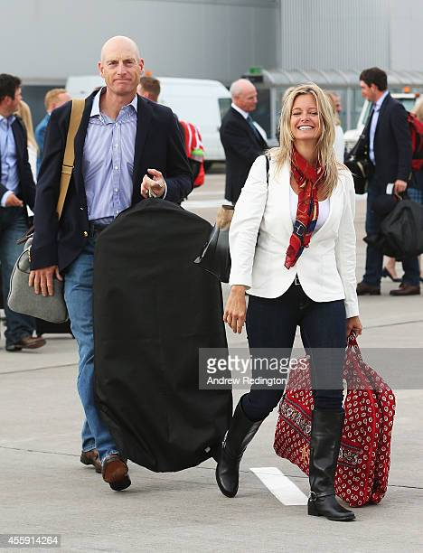 Jim Furyk of the United States and wife Tabitha Furyk arrive at Edinburgh Airport ahead of the 2014 Ryder Cup at Gleneagles on September 22 2014 in...