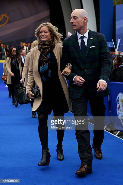 Jim Furyk of the United States and wife Tabitha Furyk leave the arena after the Opening Ceremony ahead of the 40th Ryder Cup at Gleneagles on...