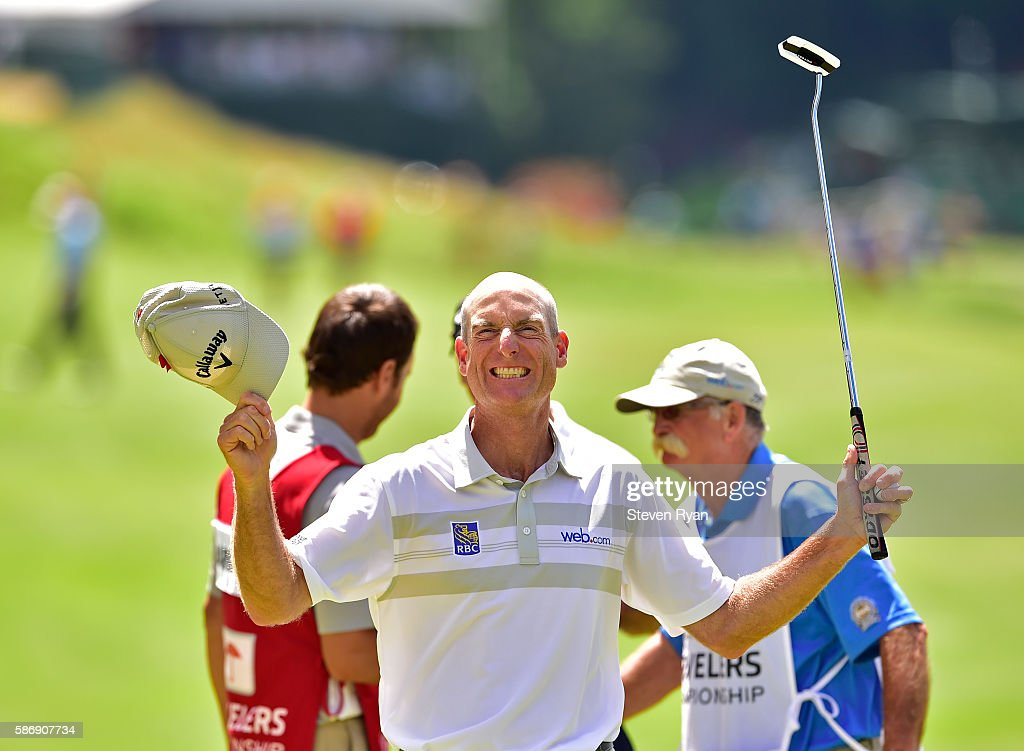 Jim Furyk of the United States celebrates after shooting a record setting 58 during the final round of the Travelers Championship at TCP River Highlands on August 7, 2016 in Cromwell, Connecticut.