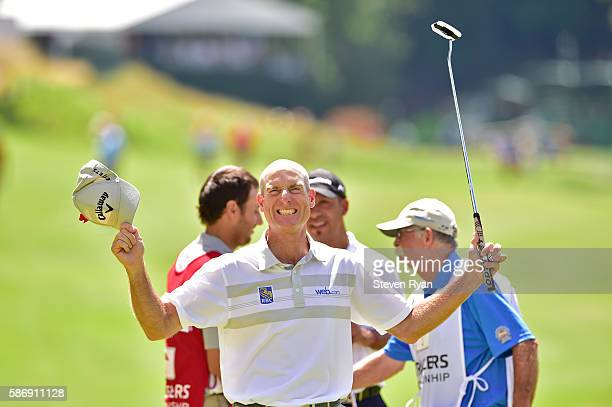 Jim Furyk of the United States celebrates after shooting a record setting 58 during the final round of the Travelers Championship at TCP River...
