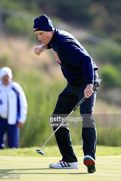 Jim Furyk of the United States celebrates his putt on the 9th hole during the Morning Fourballs of the 2014 Ryder Cup on the PGA Centenary course at...