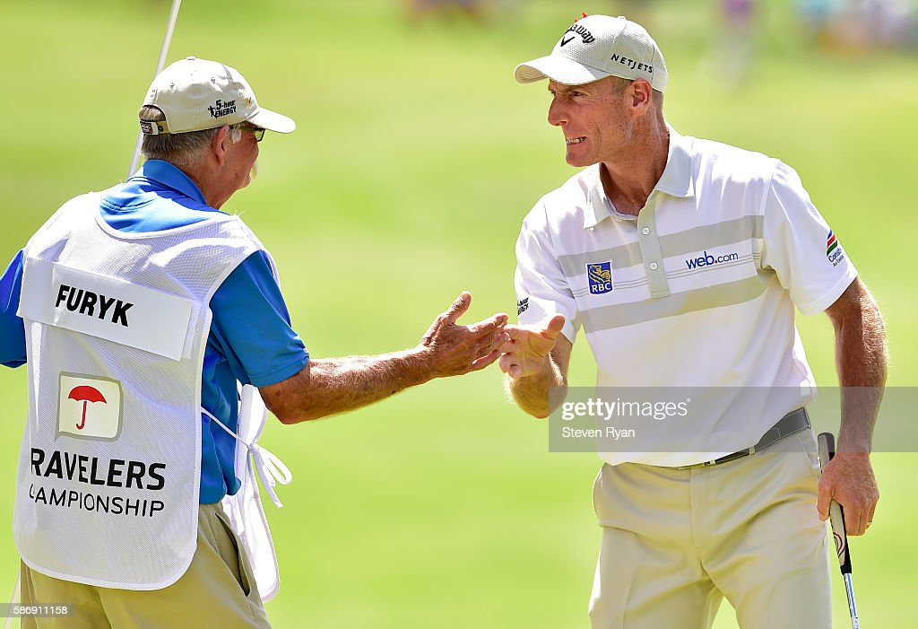 Jim Furyk of the United States celebrates with his caddie Mike 'Fluff' Cowan after a shooting a record setting 58 during the final round of the Travelers Championship at TCP River Highlands on August 7, 2016 in Cromwell, Connecticut.
