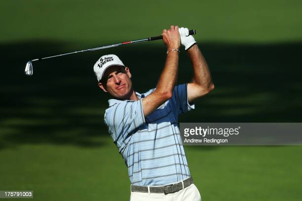 Jim Furyk of the United States hits his second shot on the tenth hole during the first round of the 95th PGA Championship on August 8, 2013 in...