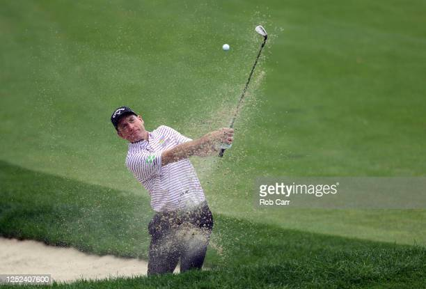Jim Furyk of the United States plays a shot from a bunker on the 15th hole during the first round of the Travelers Championship at TPC River...
