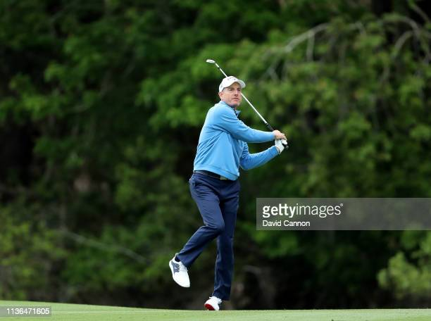 Jim Furyk of the United States plays his second shot on the par 4 14th hole during the final round of The Players Championship on the Stadium Course...