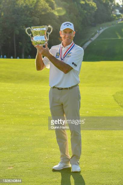 Jim Furyk of the United States poses with the trophy after winning the U.S. Senior Open Championship at the Omaha Country Club on July 11, 2021 in...