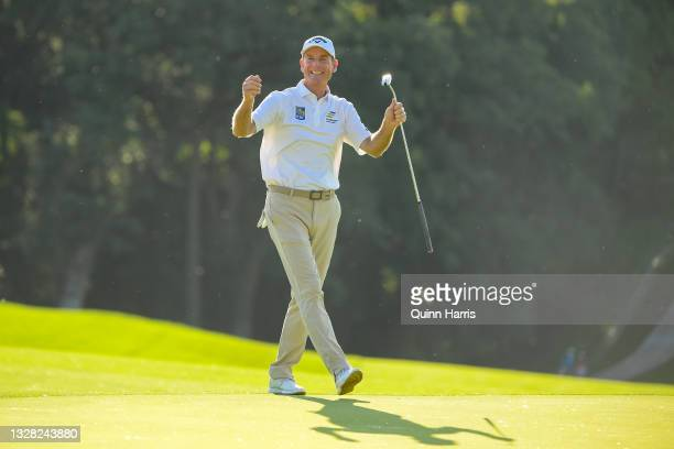 Jim Furyk of the United States reacts after his putt on the 18th hole during the final round of the U.S. Senior Open Championship at the Omaha...