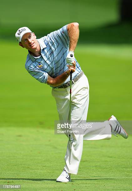 Jim Furyk of the United States reacts to his approach shot on the eighth hole during the first round of the 95th PGA Championship on August 8, 2013...