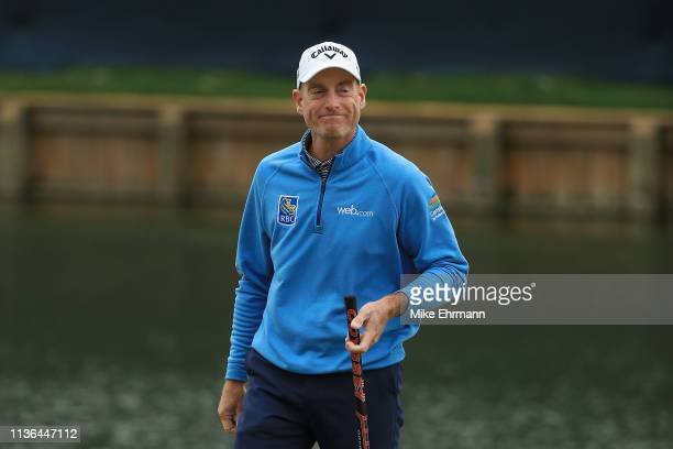 Jim Furyk of the United States reacts to his birdie on the 18th green during the final round of The PLAYERS Championship on The Stadium Course at TPC...