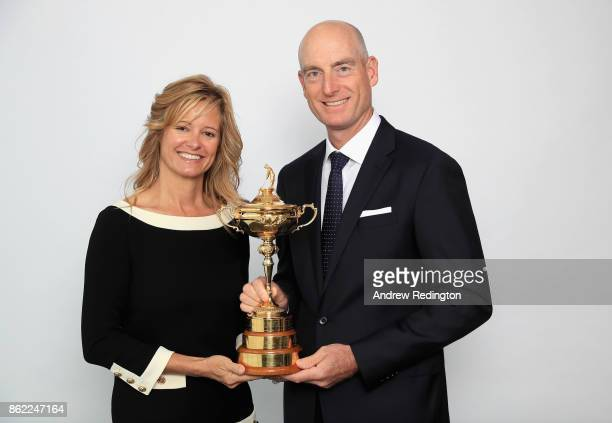 Jim Furyk of the United States Team Captain of Team America and his wife Tabitha Furyk pose for a portrait with the Ryder Cup during the Ryder Cup...