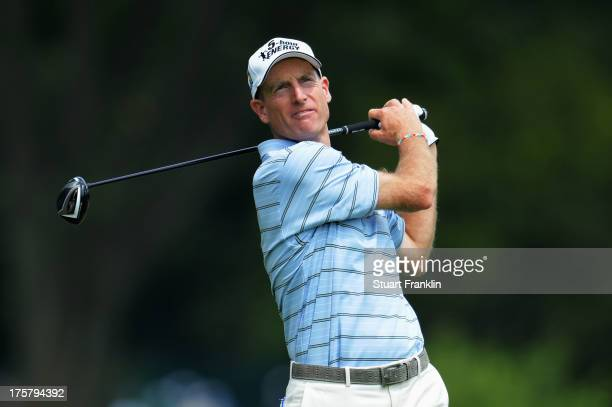 Jim Furyk of the United States watches his tee shot on the ninth hole during the first round of the 95th PGA Championship on August 8, 2013 in...