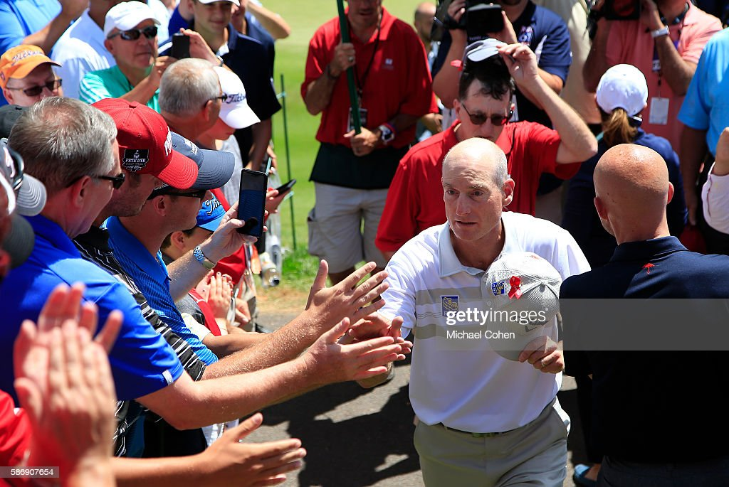 Jim Furyk of the U.S. comes off the course after a shooting a record setting 58 during the final round of the Travelers Championship at TCP River Highlands on August 7, 2016 in Cromwell, Connecticut.