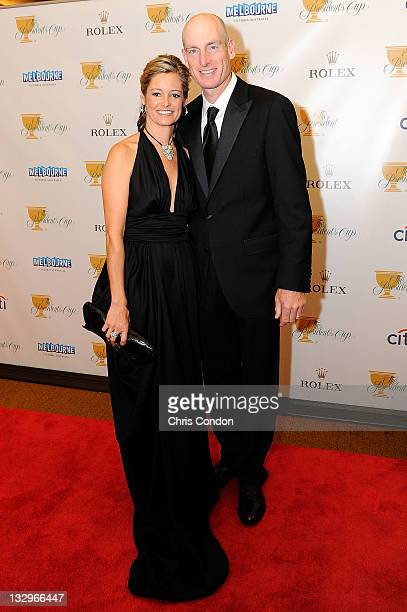 Jim Furyk of the US Team and his wife Tabitha Furyk arrive on the red carpet at the Gala Celebration for the 2011 Presidents Cup at the Crown Towers...