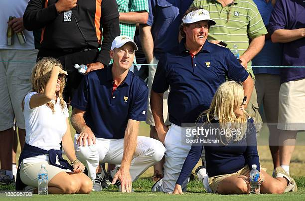 Jim Furyk of the US Team his wife Tabitha Phil Mickelson of the US Team and his wife Amy watch play on the 17th hole during the Day One Foursome...