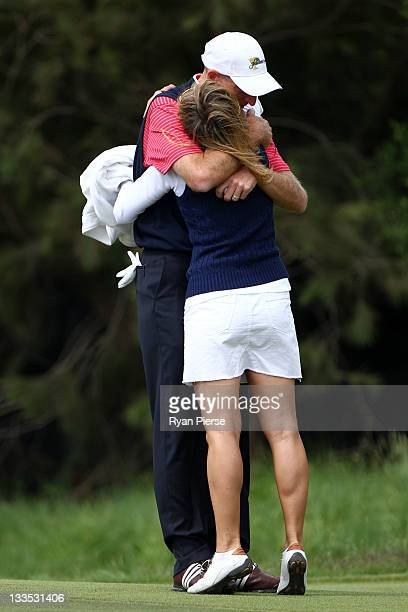 Jim Furyk of the US Team hugs his wife Tabitha Furyk after winning his match on the 15th hole during the Day Four Singles Matches of the 2011...