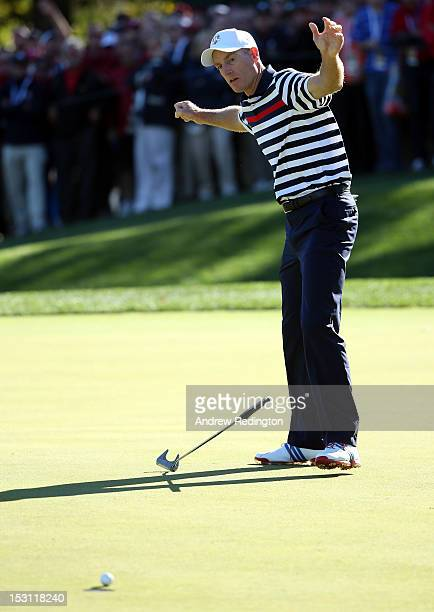 Jim Furyk of the USA reacts to a missed putt on the 16th green during the Singles Matches for The 39th Ryder Cup at Medinah Country Club on September...