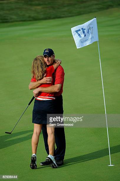 Jim Furyk of the USA team celebrates with his wife Tabitha on the 17th green after defeating Miguel Angel Jimenez 2 1 to secure the Ryder Cup for the...