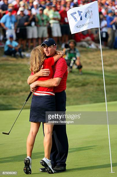 Jim Furyk of the USA team hugs his wife Tabitha after defeating Miguel Angel Jimenez 2 1 to secure the Ryder Cup for the USA during the final day of...