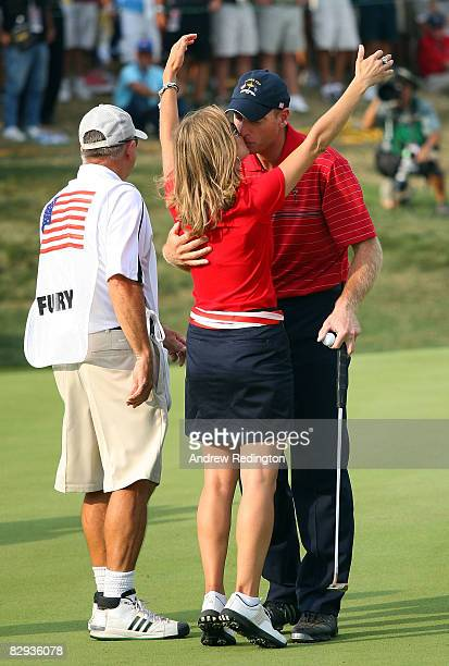 Jim Furyk of the USA team kisses his wife Tabitha after defeating Miguel Angel Jimenez 2 1 to secure the Ryder Cup for the USA during the final day...