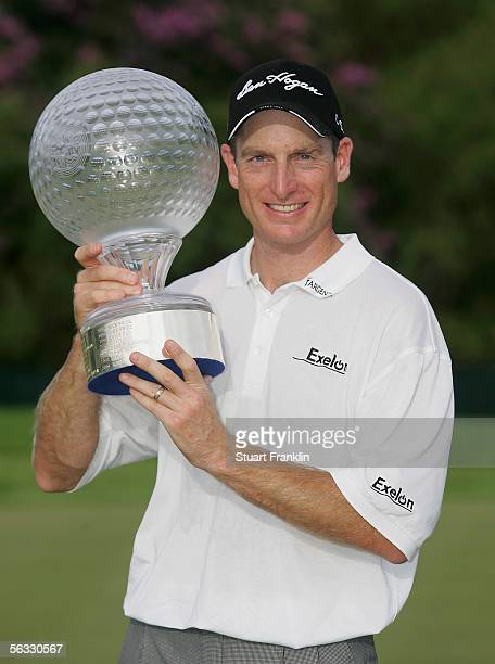 Jim Furyk of USA poses with the trophy for winning The Nedbank Golf Challenge at The Gary Player Golf and Country Club on December 4 Sun City South...