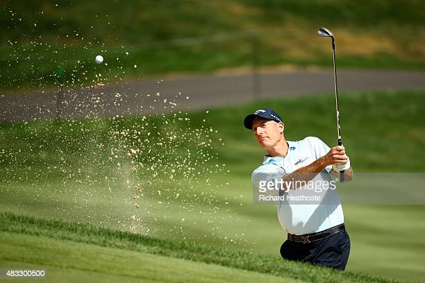 Jim Furyk plays a shot out of a bunker on the 12th hole during the second round of the World Golf Championships Bridgestone Invitational at Firestone...