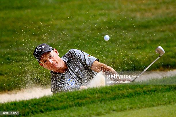 Jim Furyk plays a shot out of a bunker on the seventh hole during the first round of the World Golf Championships - Bridgestone Invitational at...