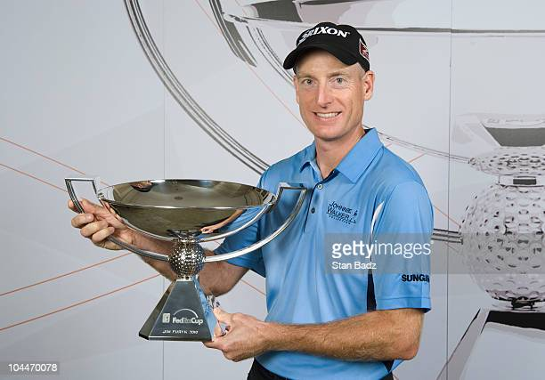 Jim Furyk poses with the FedEx Cup after winning THE TOUR Championship presented by CocaCola the final event of the PGA TOUR Playoffs for the...