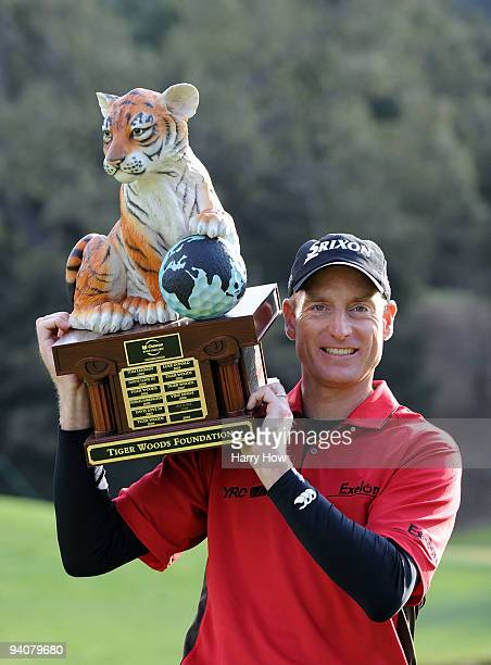 Jim Furyk poses with the trophy on the 18th hole after finishing 13 under par for the tournament during the fourth round of the Chevron World...