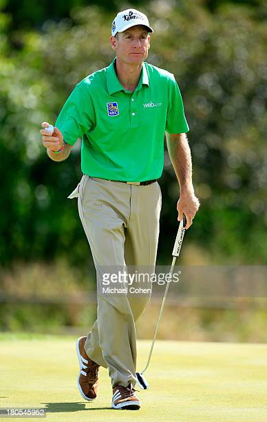 Jim Furyk reacts after a putt on the seventh green during the Third Round of the BMW Championship at Conway Farms Golf Club on September 14, 2013 in...