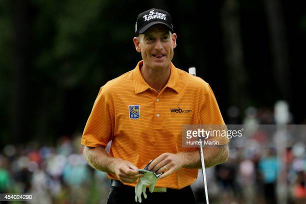 Jim Furyk reacts on the 18th green during the third round of The Barclays at The Ridgewood Country Club on August 23 2014 in Paramus New Jersey