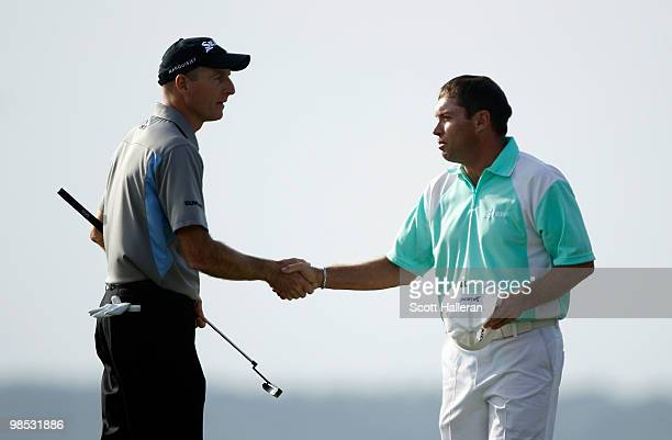 Jim Furyk shakes hands with Brian Davis of England on the 18th green during the final round of the Verizon Heritage at the Harbour Town Golf Links on...