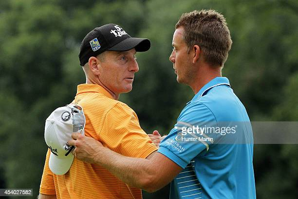 Jim Furyk shakes hands with Henrik Stenson of Sweden after they finished on the 18th green during the third round of The Barclays at The Ridgewood...
