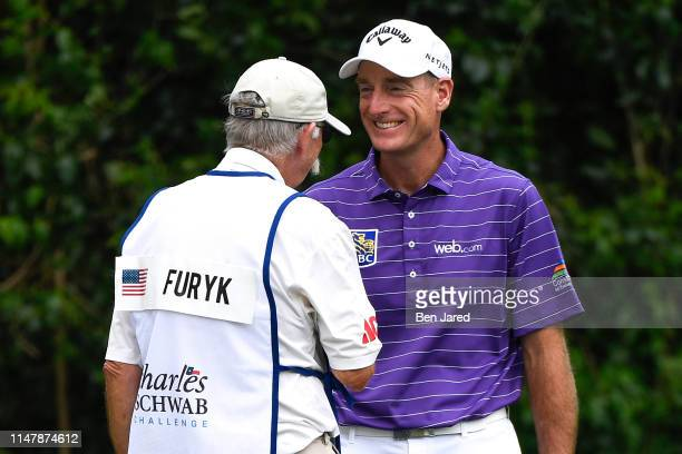 Jim Furyk talks with his caddie Mike Fluff Cowan on the fifth green during the final round of the Charles Schwab Challenge at Colonial Country Club...