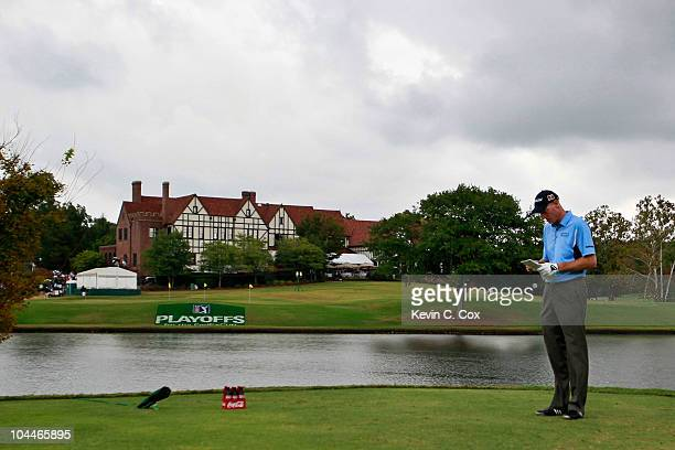 Jim Furyk waits to tee off the seventh hole during the final round of THE TOUR Championship presented by CocaCola at East Lake Golf Club on September...
