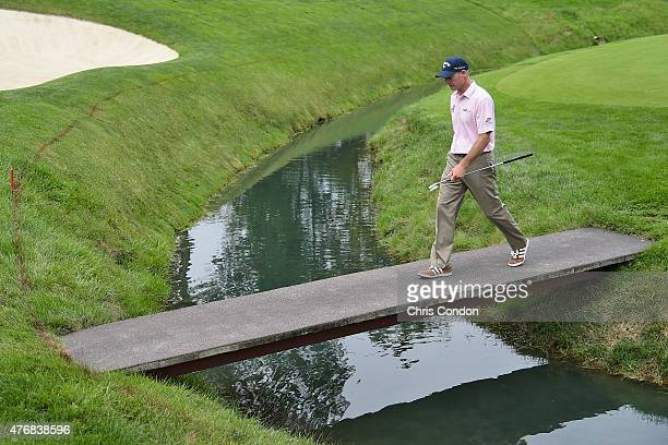 Jim Furyk walks to the 11th green during the final round of the Memorial Tournament presented by Nationwide at Muirfield Village Golf Club on June 7,...