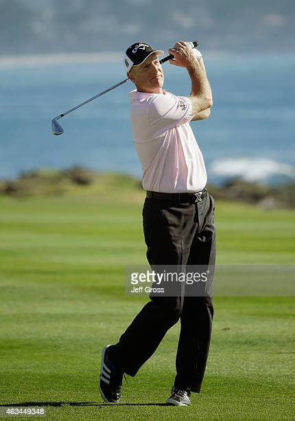 Jim Furyk watches his second shot on the 18th hole during the third round of the ATT Pebble Beach National ProAm at the Pebble Beach Golf Links on...